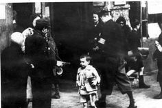 Warsaw, Poland, Street scene in the ghetto. The children in picture did not survive