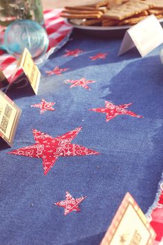 Simple table runner made from denim with appliqued bandana print stars. Great for a western theme or the 4th of July.