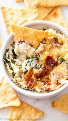 Creamy warm spinach dip made with roasted garlic, crispy bacon, and parmesan cheese. This dip was gone in minutes. Do yourself a favor and double the recipe!
