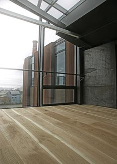 Bolefloor Wood Flooring in a Rusted Atrium | Remodelista