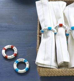 Nautical mini life preserver  napkins rings made with vintage curtain rings that were painted and stamped.