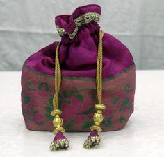 #Designer potli #bags   Plush Purple colors to add glamour to your beauty.   Shop online: http://sankalpbandhej.com/   For more pics & details/Collaboration Call/Whatsapp: 91-9377399299  #sankalpthebandhejshoppe #bandhani #bandhanisarees #dresses #bandhanidressmaterial #kurtis #designerkurtis #gharchola #banarasi #sari #dupattas #bandhanidupattas #accesories