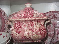 Red transferware sugar bowl with all over pattern