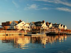 Mystic, Connecticut. The village is located on the Mystic River, which flows into Long Island Sound, providing access to the sea. The Mystic River Bascule Bridge crosses the river in the center of the village.