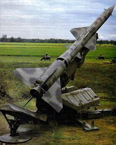 North Vietnamese - SA-2 Guideline (V-750VK Dvina) Is a High Altitude Surface-to-Air Missile Consisting of a Solid Fuel Booster, a Storable Liquid Fuel Upper Stage and a 440 lbs. War Head – Seen on its Launcher In a Rice Patty North of Hanoi, North Vietnam