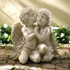 Garden sculpture of two little angels