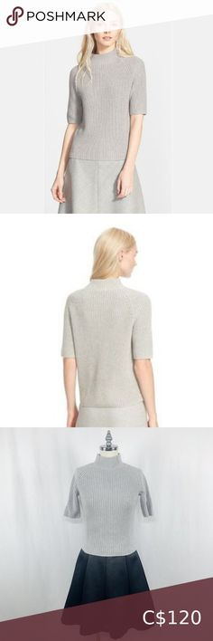 Theory Gray Jodi Mock-Neck Cotton/Cashmere Sweater A face-framing mock-neck, ring collar, pull over sweater with raglan style short-sleeves, crafted from a blend of cotton and cashmere. Thick knit with stretch in light gray - very soft and flattering. Size XS and in excellent, like new condition. - 85% cotton 15% cashmere, dry clean Theory Sweaters Cowl & Turtlenecks Wool Sweaters, Cashmere Sweaters, Slip Skirts, Face Framing, Stretch Dress, Turtlenecks, Mock Neck, Theory, Cowl