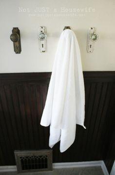 vintage door knobs as towel hooks