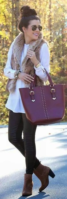 White shirt, faux fur and oversized bag.