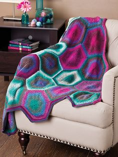 Free Knit Pattern Download -- This Hexagon Afghan, designed by Sandi Rosner, is featured in episode 1, season 4 of Knit and Crochet Now! TV. Learn more here: https://www.anniescatalog.com/knitandcrochetnow/patterns/detail.html?pattern_id=7&series=2