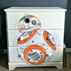 As part of a boy's bedroom makeover, an unfinished wood dresser gets a custom furniture makeover. It's hand painted to look like the Star Wars BB8 Droid. Just a Little Creativity featured on Kenarry.com