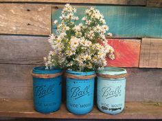 Set of three pint size mason jar #vases in beachy shades of #turquoise and aqua. You can choose this color scheme or choose your own. This set is heavily distressed. You can ... #jars #gifts #rustic #distressed #beach #aqua