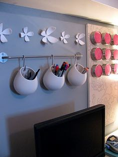 I love the hanging pen cups! Some great ideas for a small office space.could also hang metal buckets