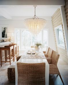 Bohemian Dining Room - A capiz-shell chandelier above a white dining table