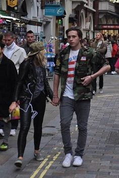 Brooklyn Beckham wearing Stan Ray Four Pocket Fatigue Jacket and Converse Chuck Taylor All Star 2