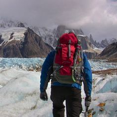 Trekking at the foot of Fitzroy, across massive glacial fields is one of the coolest (ha!) things I've ever done, period. This shot is of my guide leading us across the ice -  in the distance Fitzroy is shrouded in clouds. #patagonia #argentina #fitzroy #climb #trek #glacier #hike #mountain #mtfitzroy