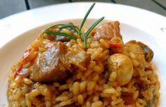 La divinidad en tu plato: Arroz con pollo y cerdo ibérico. | 16 Deliciosas recetas con arroz que mejorarán tu vida entera