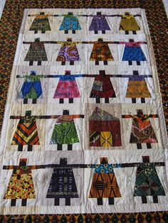 I created a quilt pattern based on this quilt and am using lovely fabrics I bought in Benin to make this wonderful African ladies quilt.