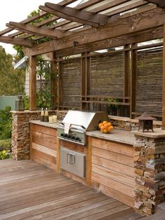 Outdoor Kitchens Built In Grill Design- like the location of girll & privacy. May do different wood/stone though.Built In Grill Design- like the location of girll & privacy. May do different wood/stone though. Diy Outdoor, Outdoor Kitchen Design, Kitchen On A Budget, Rustic Outdoor, Outdoor Cooking, Rustic Outdoor Kitchens, Outdoor Kitchen, Outdoor Kitchen Countertops, Grill Design