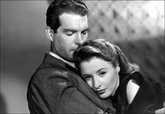 "Fred MacMurray and Barbara Stanwyck in ""Remember the Night,"" a 1940 film written by Preston Sturges and directed by Mitchell Leisen. Old Hollywood, Golden Age Of Hollywood, Classic Hollywood, Barbara Stanwyck, Movie Stars, Movie Tv, Top 10 Films, New York Times Arts, Face The Music"