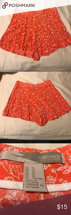 Orange and White Floral Shorts Orange and white floral flowy shorts. They are perfect for the summer time! Tag says XS but actually fits a Small. Forever 21 Shorts
