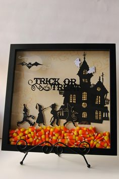 This cute Halloween display was made with a shadow box and a cricut. You could print a scene off the internet or draw your own outline and cut it out of black paper. I love the bright candy corn in the bottom. Great idea to do for any holiday. Halloween Shadow Box, Halloween Cards, Holidays Halloween, Spooky Halloween, Happy Halloween, Halloween Decorations, Halloween Frames, Christmas Shadow Boxes, Christmas Blocks