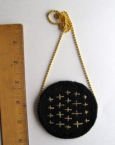 Embroidered gold pendant necklace on black by AnAstridEndeavor