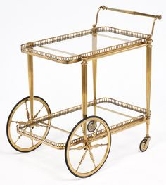 French Art Deco Brass Bar Cart-- we love the oversized front wheels!