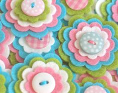 Felt flower embellishments add a special touch to your craft projects from hair accessories to decorating photo frames, purses, pillows and much more. {D E T A I L S } * You will receive 3 x COOPER felt flowers. You may not receive the exact ones as shown but they will still be just as cute :) * Each one is made using 4 layers of felt with a cute button sewn on top * I use a mix of felt - acrylic, wool mix etc * The measure approx 1.5 each * The individual layers measure 1.5, 1.25, 1 and…