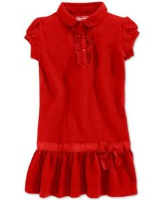 She doesn't need uniforms but she loves this uniform dress. What kind of cool school has this as a uniform option? Nautica Girls' Uniform Ruffled Polo Dress