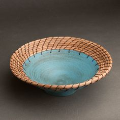 Turquoise Plate by Hannie Goldgewicht. In a distinctive combination of materials and textures, the artist weaves pine needle basketry along the edge of a wheel-thrown ceramic plate. Each piece is unique and will vary. Slab Pottery, Pottery Bowls, Ceramic Pottery, Pottery Art, Pottery Studio, Pottery Handbuilding, Pine Needle Baskets, Wheel Thrown Pottery, Clay Bowl