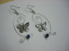 swirly butterfly wire earrings. Im not even a butterfly person and I like these