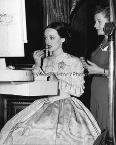 """Juarez"" 1939.  Margaret Donovan assists Bette Davis with hair & make-up."