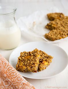 "peach oatmeal bars from ""fat free vegan"" (rolled oats, dates, almonds, chia or flax, baking powder, cinnamon, almond milk, peaces, vanilla & almond extract!)"