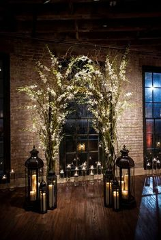 30 Winter Wedding Arches And Altars To Get Inspired: #10. Indoor branches and flowers arch with lots of candle lanterns