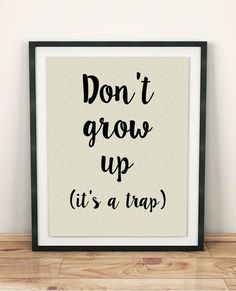 Dont grow up. Its a trap is very original and playful print for kids. This awesome and funny quote is the perfect addition to your kids room :) You