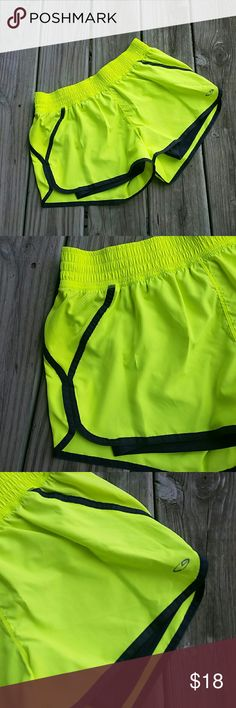 Champion neon yellow running shorts with spandex Champion neon yellow running shorts with built in black spandex shorts. Elastic waist band with a front tie to tighten. Size MEDIUM. Champion Shorts
