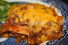 Beef enchilada casserole. Slow cook small roast in crock pot, shred, and use in place of ground beef. Add black beans. ROCKS! #beef or #chicken #main