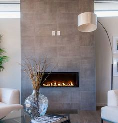 Grey stone modern fireplace remodel modern Best Amazing Fireplace Tile Ideas for Your Living Room - homelovers remodel stone Fireplace Tv Wall, Wall Mount Electric Fireplace, Fireplace Remodel, Living Room With Fireplace, Fireplace Surrounds, Living Room Decor, Fireplace Modern, Fireplace Ideas, Modern Electric Fireplace