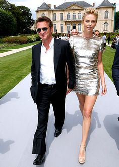Sean Penn and Charlize Theron held hands leaving the Musee Rodin, site of the Christian Dior Paris Fashion Week show. Charlize's dress is to die for!