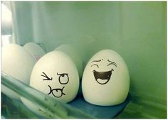 funny faces drawn eggs