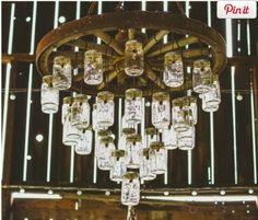 wagon wheel mason jar chandelier alternating length wagon wheel mason jar