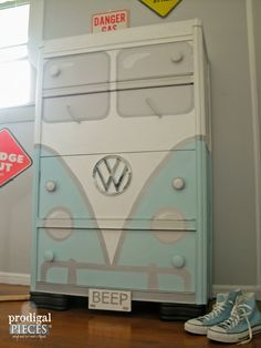 A garage sale freebie Art Deco water dresser gets a sweet Volkswagen Bus makeover.