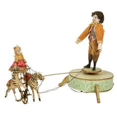 "An antique wind-up circus toy approximately 12"" tall"