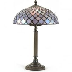 A stunning Tiffany table lamp with a pale iridescent blue Tiffany glass shade. The Nelson is a quality Tiffany lamp from our Period Lighting Collection which features reproduction lights from the Victorian and Edwardian era. Beautiful Table Lamp, Lighting Collections, Stained Glass Light, Lamp, Glass Shades, Cool Lighting, Tiffany Table Lamps, Lights, Period Lighting