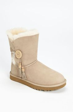 The ubiquitous UGG! Australia 'Bailey Charms' Boot with button and tassels to set it off.