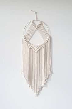 This large macrame dreamcatcher wall hanging is carefully handcrafted with cotton rope and gold metal hoop. This wall hanging combines simplicity and charm to warm up any little nook in your home or office. Youll adore its lovely texture and minimalis Macrame Wall Hanging Patterns, Large Macrame Wall Hanging, Macrame Patterns, Hanging Wall Art, Wall Hangings, Hanging Lamps, Diy Hanging, Macrame Design, Macrame Art