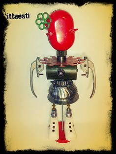 Bella Vale by ittaesti, robot sculpture assembled with metal found objects