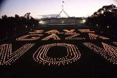 """Australian activists form the words """"Save Gaza Now"""" with candles in solidarity with Gaza."""