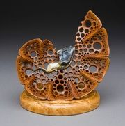 Wood sculpture with removable jewelry pendant.  Wood sculpture by Mark Doolittle; Jewelry by Michele Foster.